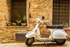 Vintage scene with Vespa on old street Royalty Free Stock Photos