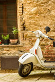 Vintage scene with Vespa on old street Royalty Free Stock Photo
