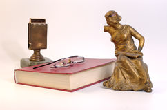 Vintage scenery. Scene with a book, matches and bronze statuette Stock Photos