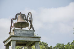 Vintage School Bell. Cast iron antique school bell on tower stand with room for text on right side Royalty Free Stock Images