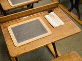 Vintage School Desk and Slate. A vintage school desk and chalk board or slate as was used in the early 1900's Royalty Free Stock Image