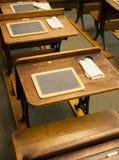 Vintage school desks. A few retro circa 1900's school desks, drawing or wrtiting tablets in a schoolroom Stock Photos