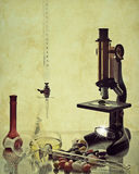 Vintage Science. Food samples with microscope and glassware with texture for vintage look and feel stock photo