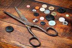 Vintage scissors and buttons Stock Images