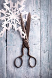 Vintage scissors and handmade paper snowflake Royalty Free Stock Photography