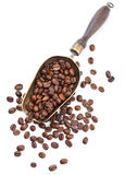 Vintage scoop with coffee beans isolated on white Stock Photos