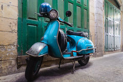 The vintage scooter Royalty Free Stock Images