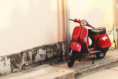 Vintage scooter parked near a building wall Royalty Free Stock Photo