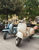 Vintage scooters Vespa and  Lambretta Stock Photos