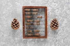 Vintage scores and cones on concrete table. Top view. Ancient methods of counting Royalty Free Stock Images