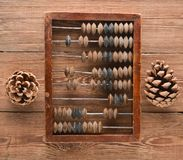 Vintage scores and cones on wooden table. Top view. Ancient methods of counting Stock Images