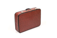 Vintage scratched brown suitcase on white. Royalty Free Stock Photo