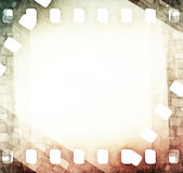 Vintage scratched film strip background. Vintage light scratched film strip background Royalty Free Stock Image