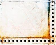 Vintage scratched film strip borders. Grunge design element Stock Images