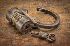 Vintage screw type iron padlock Royalty Free Stock Images