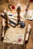 Vintage scrolls and candles are the old scribe's workplace Royalty Free Stock Images