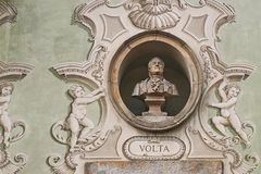 Vintage sculpture portrait of Alessandro Volta on a facade of an old building in Bellinzona, Switzerland. Vintage sculpture portrait of Alessandro Volta, an Stock Photography
