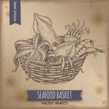 Vintage seafood basket sketch with octopus, crab, shrimp and squid Royalty Free Stock Photography