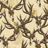 Vintage seamless background with a deer skull Royalty Free Stock Images