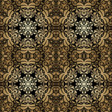 Vintage seamless background with lacy ornament. Golden pattern,. Wallpaper, web background, surface textures, classic fabric Stock Photography