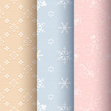 Vintage seamless classic set. Collection of beige, blue and light pink vintage seamless classic patterns with white floral, snowflakes and roses ornament on a Stock Images