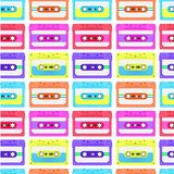 Vintage seamless pattern with analogue music cassettes. 80s Loopable background with magnetic audio tapes. Vintage seamless pattern with analogue music royalty free illustration