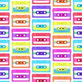 Vintage seamless pattern with analogue music cassettes. 80s Loopable background with magnetic audio tapes. Vintage seamless pattern with analogue music stock illustration