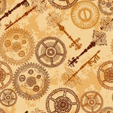 Vintage seamless pattern with gears of clockwork and antique keys on aged paper background. Royalty Free Stock Photography