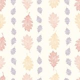 Vintage seamless pattern from the leaves of red oak arranged vertically on a beige background. Quercus rubra Stock Photo