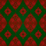 Vintage seamless pattern with red lacy ornament. Stock Photos