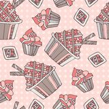 Vintage seamless pattern with sweet cupcakes Stock Photo