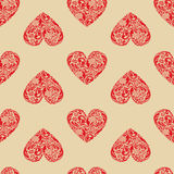 Vintage seamless texture with red hearts. Stock Photos