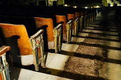 Vintage Seats - Abandoned Variety Theater - Cleveland, Ohio. A view of vintage, antique seats inside the abandoned Variety Theater in Cleveland, Ohio royalty free stock image