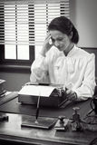 Vintage secretary with headache Royalty Free Stock Images
