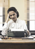 Vintage secretary with headache Stock Photography