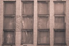 Vintage sepia background. Narrow windows of an old building stock image