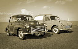 Vintage sepia morris minors. Sepia vintage photo of two morris minor cars on display at the whitstable vintage car show on 17th august 2014.photo ideal for Royalty Free Stock Photography