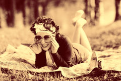 Vintage sepia portrait of a girl in summer forest Royalty Free Stock Photos