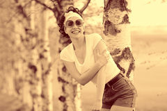 Vintage sepia portrait of a girl in summer forest Stock Photos