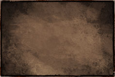 Vintage sepia texture framed. An old and scratched texture sepia framed Royalty Free Stock Photo