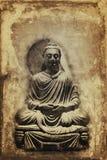 Vintage sepia toned seated Buddha statue Royalty Free Stock Image