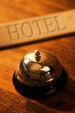 Vintage service bell at old hotel reception desk Royalty Free Stock Photos