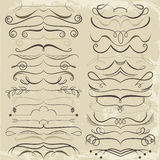 Vintage Set of calligraphic elements for design. Decorative Swirls, Scrolls, Dividers. Vintage Vector Illustration in brown tones Stock Photography