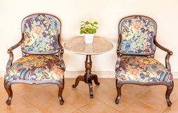 Vintage set chairs and table with vase decoration, interior Royalty Free Stock Photos