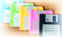 Vintage set of floppy discs on wooden desk background Royalty Free Stock Photo