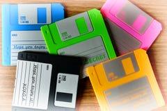 Vintage set of floppy discs on wooden desk background Royalty Free Stock Images