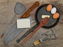 Vintage set for frying eggs over wooden table Stock Photos