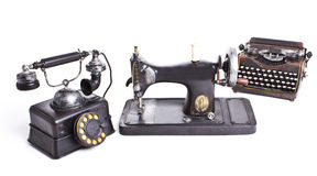 Vintage set. Old telephone, sewing machine, typewriter Stock Image