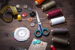 Vintage set of threads, scissors and buttons Royalty Free Stock Photo
