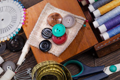 Vintage set of threads, scissors and buttons Stock Photo
